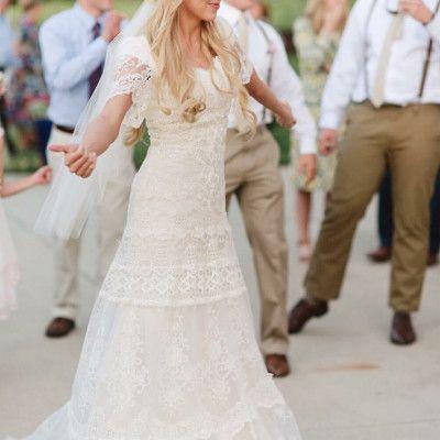 Boho modest wedding dress with flutter sleeves from alta moda