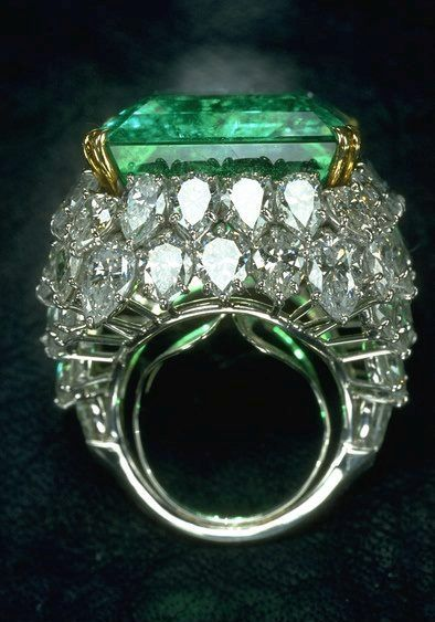 The Chalk Emerald Ring ranks among the very finest of Colombian emeralds. The top quality emerald was previously the centerpiece of an emerald and diamond necklace that belonged to the most flamboyant Maharani of Baroda, Maharani Sita Devi.  Harry Winston purchased the necklace, and after recutting the emerald from its original 38.40 carats to 37.82 carats, set it in a platinum ring surrounded by 60 pear-shaped colorless diamonds, with a total weight of 15 carats.