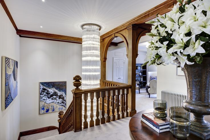 Landing with bespoke chandelier in Grade II listed Georgian manor house conversion apartment designed by www.aji.co.uk