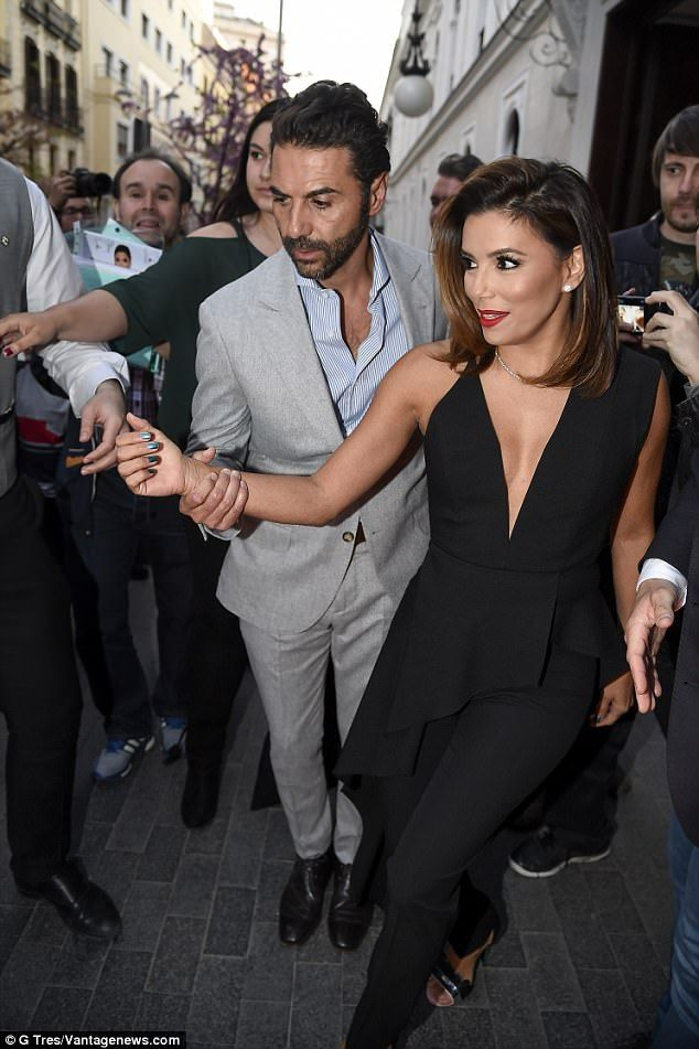 Muy Caliente! Eva Longoria and her husband Jose Baston scrubbed up for a night on the town...