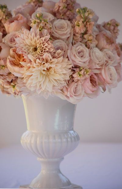 Wow, I love this. Sweet, blush arrangement of candy bianca roses, cafe au lait dahlias, Juliet garden roses, and peach stock.