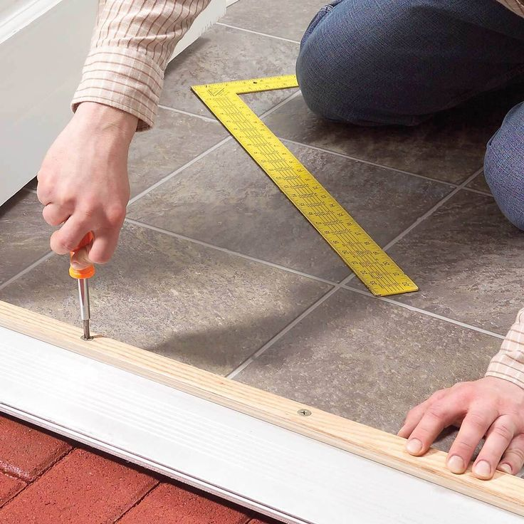 Stop drafts coming under a door by raising the adjustable threshold. It only a minute to turn the four adjusting screws.