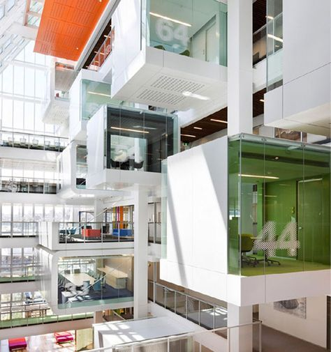 Commercial Interiors. Macquarie Group headquarters in Sydney. Meeting rooms over lobby. Architect: Clive Wilkinson.