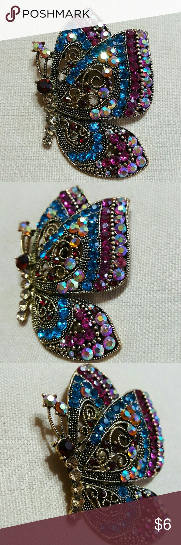 """Butterfly Pendant Brooch Butterfly Pendant Filled with beautiful rhinestones & perfect for dress up or those comfty days.  Its shy of 3"""" tall from point to point.  Feel free to ask any questions before purchasing.   Thank you for shopping my closet. Jewelry Brooches"""