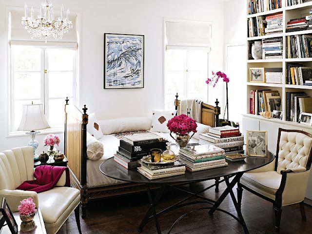 Beautiful living/office space. Like the white walls and white curtains.