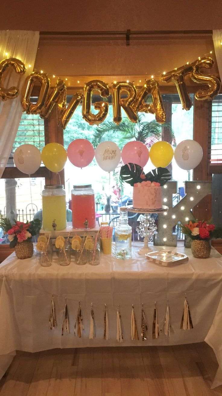 Flamingo and Pineapple Graduation Party turned out so cute with our decal balloons and lemonade stand! Accented with our gold pineapple flower arrangements.