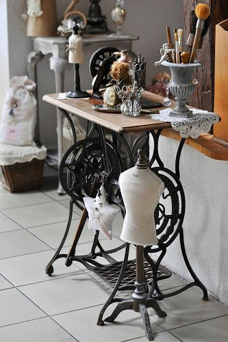 Antique sewing machine with table ~ love how she arranged her atelier so beautifully!