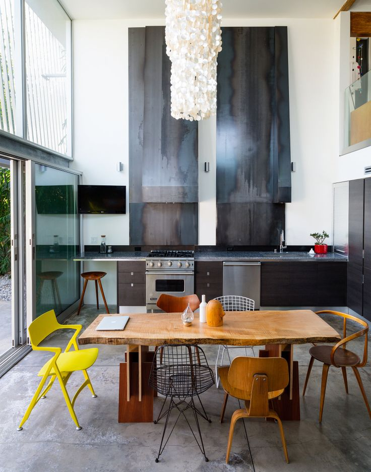eclectic mismatched chairs #mid-century_modern #industrial #kitchen
