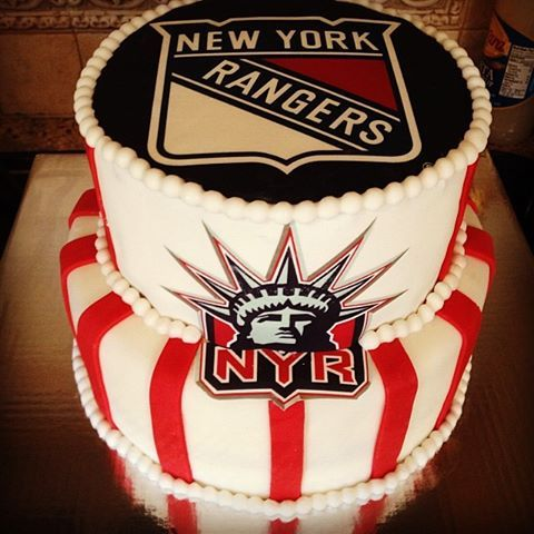 New York Rangers Cake - Groom's cake Small american flag on top Middle layer blue with small stars going around funfetti