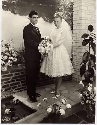 Young couple getting their photo taken on their wedding day, in 1965.