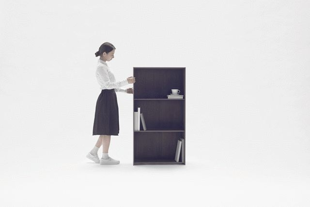 """Nendo's Carbon Fiber Bookshelf Stretches To Any Size You Need - The Nest is a Russian nesting doll shelving unit which can be pulled apart to """"grow"""" to any size and configuration you want.  Here's something that's happened to everyone. You've got a pile of books just sort of hanging out looking like a bomb went off. So you decide to buy some shelves for them."""