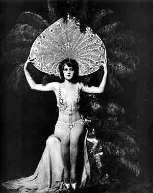 Ziegfeld Follies. Classic. Here is Katherine Burke in a headdress designed by John Harkrider. This kind of look became a trademark of the Follies.