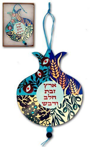 Eretz Zavat Chalav Ve'Devash Pomegranate Wall Hanging by World of Judaica. $29.00. Eretz Zavat Chalav Ve'Devash is written in the center with four major harvest foods in different sections of the pomegranate shape of this creative wall hanging. This vibrant colored wall hanging is in the shape of the beautiful pomegranate. Eretz Zavat Chalav Ve'Devash, The Land of Milk and Honey in Hebrew, is written in the center with a light blue, circular background. The remai...