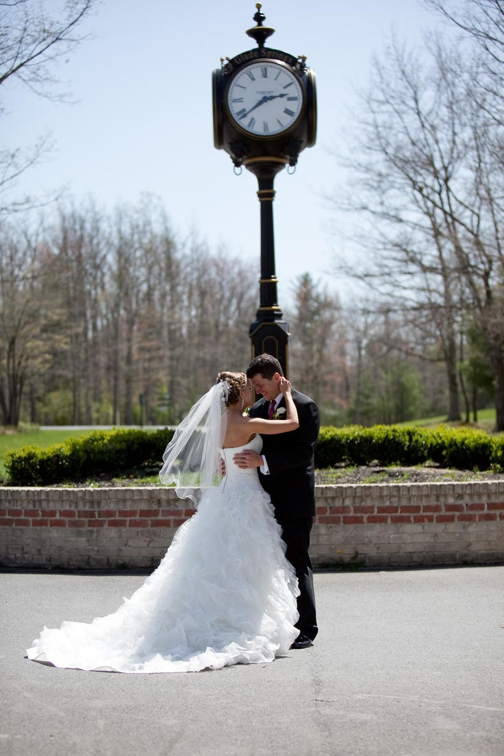 "An ""impromptu"" shot of newlyweds in front of the clock tower in the Glade Springs Town Square."