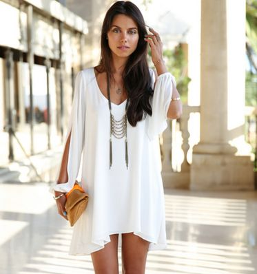 This elegant Bikini Luxe Wanderlust White Chiffon Dress is perfect for a long day of window shopping. The loose fit of this summer dress makes it ultra comfortable, and the long sleeves are slit down to the wrists, giving you a luxurious look. The Wanderlust chiffon dress is made of silky white soft fabric, and flows beautifully in the wind.   Small: Bust 33.5in / Length 29.5in / Sleeves 21.3in Medium: Bust 34.5in / Length 30.5in / Sleeves 22.5in  #whitedress #summerdress #whitechiffondress