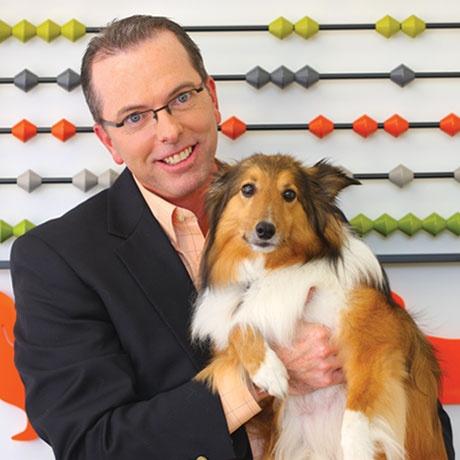 "Terry Malloy, ""Chief Bone Counter"" (AKA Petplan pet insurance Chief Financial Officer) with Buddy the Shetland Sheepdog"