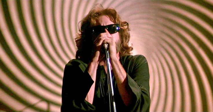 Val Kilmer Shares Rare Doors Movie Rehearsal Video -- Val Kilmer shows off old footage of himself in character as Jim Morrison rehearsing at Whiskey a Go Go in the 1990s for Oliver Stone's biopic. -- http://movieweb.com/the-doors-movie-1991-val-kilmer-rehearsal-video-jim-morrison/