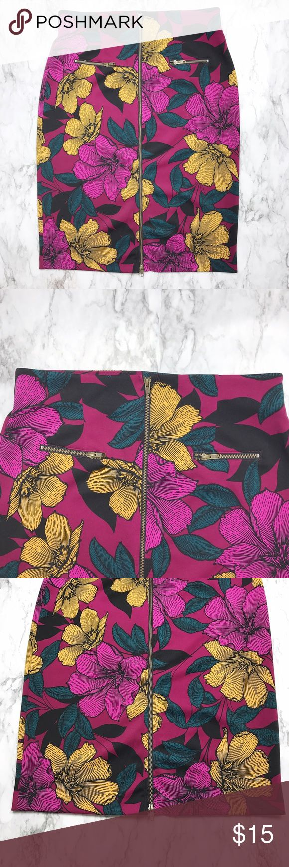 """Plus 14 Floral Pencil Skirt Worthington Fuchsia Gorgeous bold floral print Worthington Plus size 14 pencil skirt.  Pretty purple magenta like color with teal, gold and black in the pattern.  Zips from top to bottom and has two faux zipped pockets on the front.  MEASUREMENTS  Length 27""""  Waist 32"""" Worthington Skirts Pencil"""