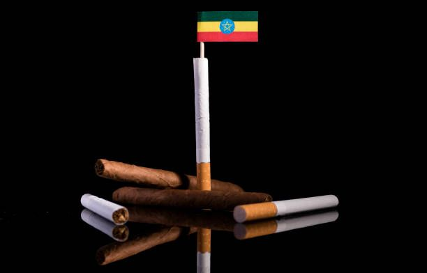ethiopian flag with cigarettes and cigars tobacco industry concept