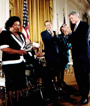 42nd President Bill Clinton presents the Presidential Medal of Freedom to Cesar Chavez's wife, Helen Chavez, in his honor at a ceremony held at the White House (1994)