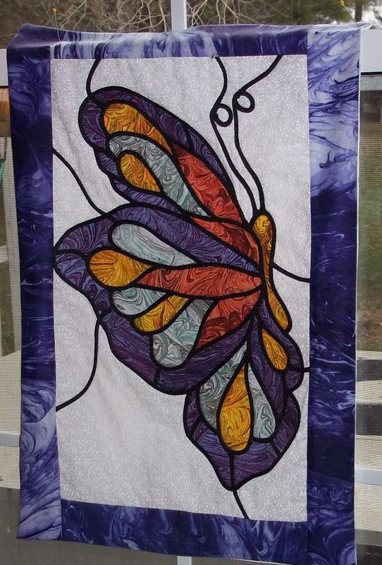 butterfly quilt - I want to make one in this stained glass style some day: