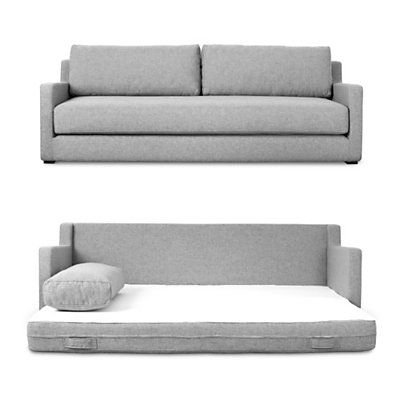 Grey Fold out sofa bed - it's very hard to find a stylish sofa bed but this one looks fantastic both ways and the cushions can be removed to make pillows.