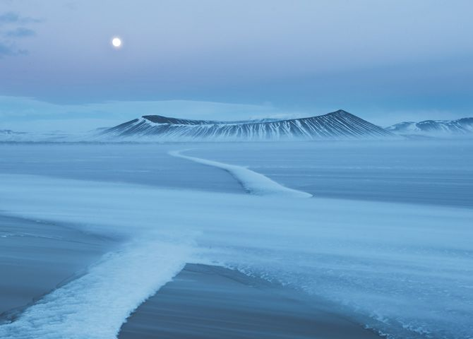 When Hverfjall erupted 2,500 years ago, no one saw it—no one lived in Iceland. On a March evening photographer Orsolya Haarberg watched alone as a north wind scoured Mývatn lake's thin ice, sweeping snow into a drift that looked like a path to the crater.  This volcano is not featured in Life Erupted, but it did inspire me in my writing.
