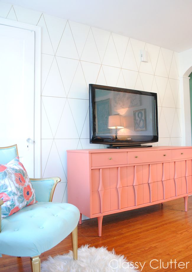 DIY Diamond Wall + coral dresser makeover + spray painted & newly upholstered chair. Lots of great projects in this pretty reading room makeover @Mallory {ClassyClutter.net}