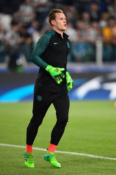 Barcelona's German goalkeeper Marc-Andre Ter Stegen warms up before the UEFA Champions League quarter final first leg football match Juventus vs Barcelona, on April 11, 2017 at the Juventus stadium in Turin.  / AFP PHOTO / MIGUEL MEDINA