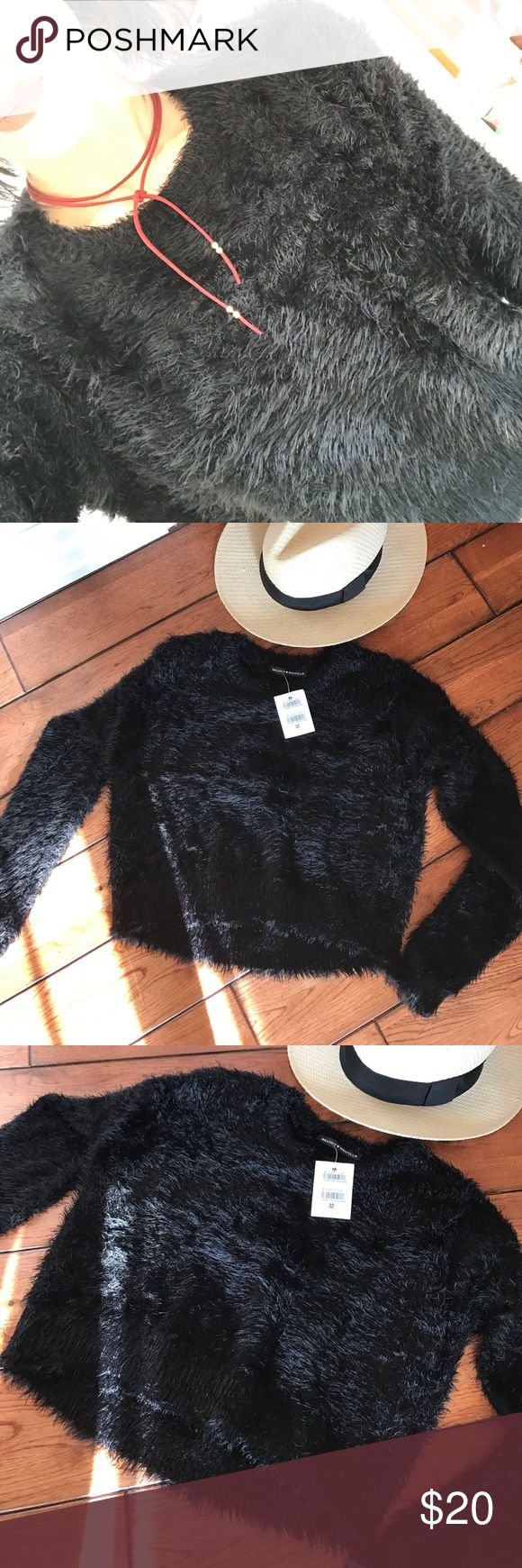 Furry black cozy NWT Brandy Melville sweater💋 Furry black cozy NWT Brandy Melville sweater💋 size 32, I believe that's a small. Very cozy and luxurious I got brand new from another Posher but I don't love the way it fits me. It's a beautiful sweater, a little bit higher in the front than back, making for a very trendy almost crop top type look!! 🌑🔮 Brandy Melville Sweaters Crew & Scoop Necks