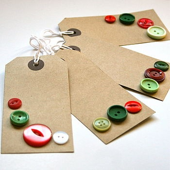 Handmade Christmas gift tags made using red, green and cream vintage buttons on large brown tags.