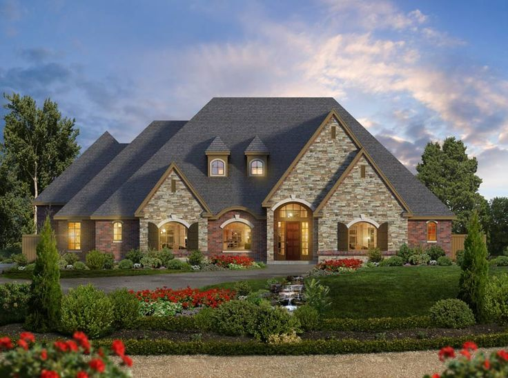 architecture luxury tuscan ranch home plan with front yard garden and entry way to framed glass