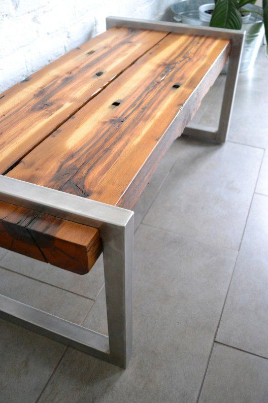 The Railroad Tie Bench ($650) is made with  stainless steel and reclaimed oak railroad ties from Virginia's capitol of Richmond. The holes in the wood are left from where the railroad spikes were driven through the ties.