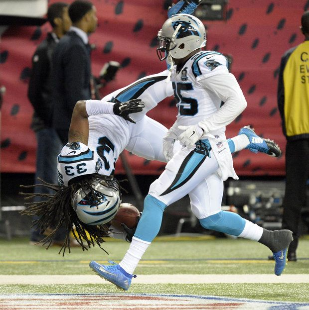 Carolina Panthers' Tre Boston (33) flips into the end zone after intercepting an Atlanta Falcons pass in the third quarter at the Georgia Dome on Sunday, December 28, 2014. Carolina won 34-3 and won the NFC South Division.