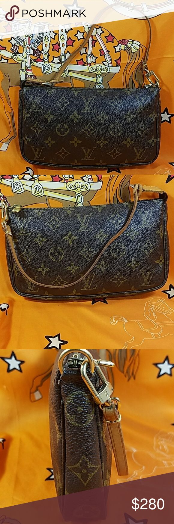 "Authentic Louis Vuitton Monogram Pochette The outer canvas is in good condition. The leather strap (drop about 6.25"") is slightly darkened. Inside is nice and clean. This is a pretty nice pre-owned bag. Date code VI0032. It made in France. Dimension:( about) 5, 8 & 1.25. No trade please. Louis Vuitton Bags Clutches & Wristlets"