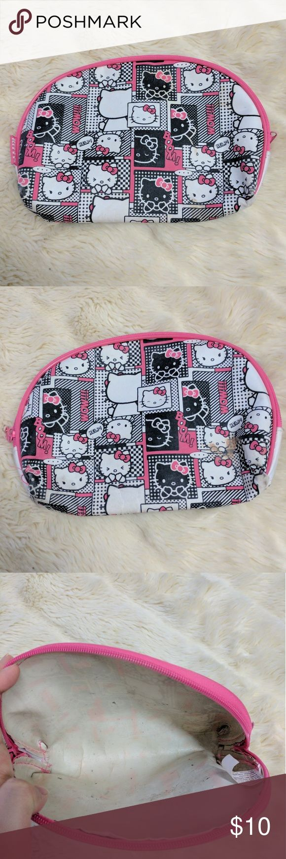Hello Kitty Makeup Bag This is a pink, black, and white Hello Kitty cosmetics bag with a comic book style print. Has some make up stains, as pictured, but still in good condition. Hello Kitty Bags Cosmetic Bags & Cases