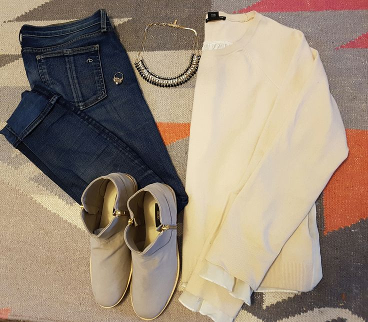 Buttery soft Berlin Zip-Up Booties paired with jeans, a soft pink sweater, and some chunky jewelry.