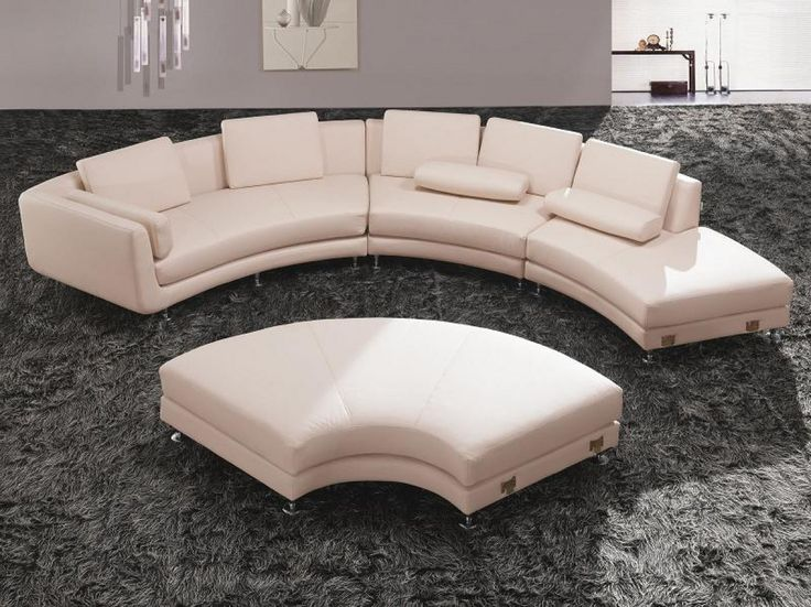 Divani Casa A94 White Sectional Sofa & Ottoman - Can form a circular shape or an 'S' shape with ottoman - Set includes sectional and moveable ottoman - Pillows included Dimensions: 2 Seater With Arm: