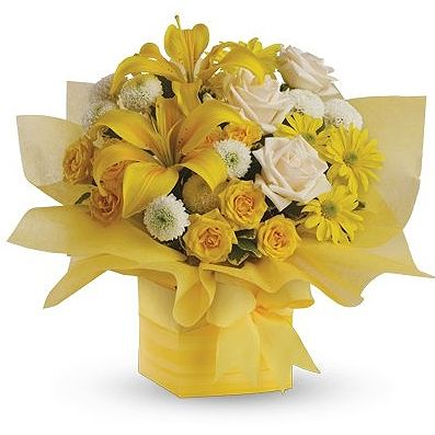 This sunny array of flowers in a decorative mini box makes a tantalizing gift for someone with taste