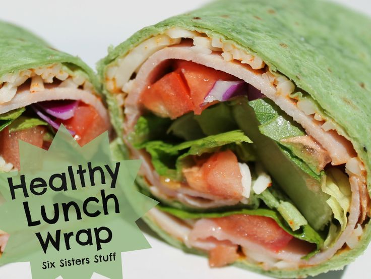 Easy Healthy Lunch Wrap - mayo, taco seasoning, mozzarella cheese, turkey, tomato and lettuce on a spinach wrap.
