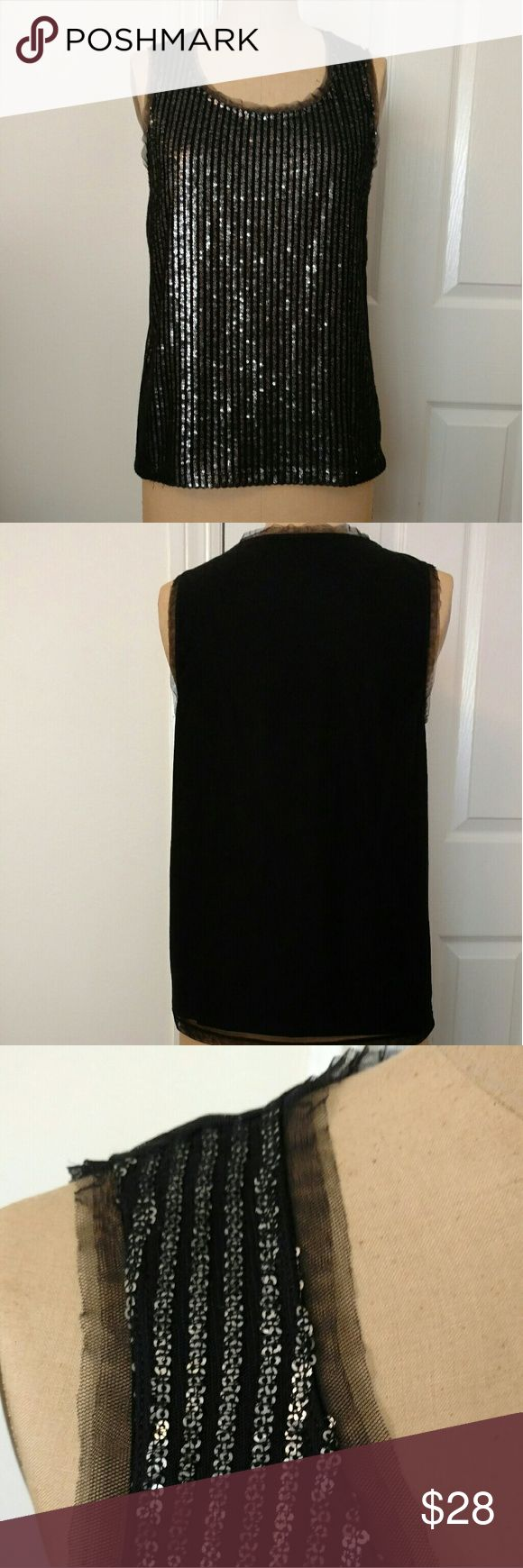 Chicos Sequin Shell Black sequin shell. The sequins are all stitched down- no snagging or loosing sequins! A very creative application. The edges are raw net. Chico's Tops Tank Tops