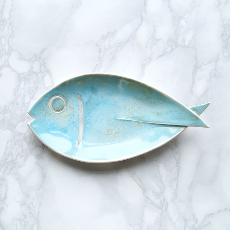 Porcelain fish soap dish with cutout gill to help drain the water and keep soap…