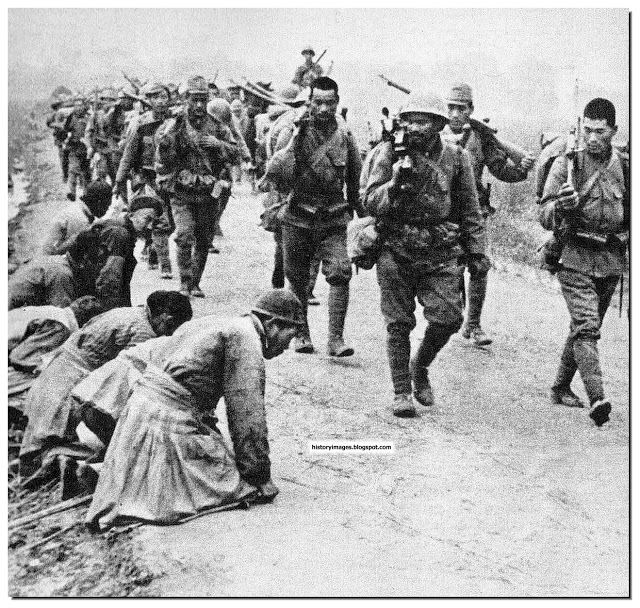 Chinese people made to kneel as Japanese soldiers pass