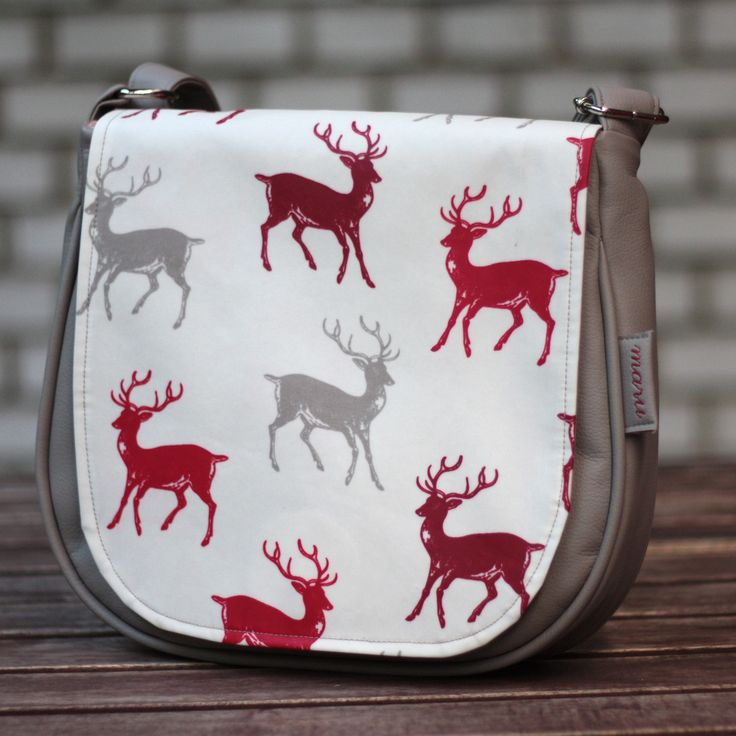 Watch out - deers! Fancy designers fabric with deer pattern, and in addition it is waterproof - your best friend for the rainy autumn time.