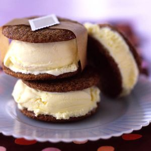 Sandwich creamy lemon ice cream between crisp gingerbread cookies for a cool treat from Epicurious. #Gingersnap #Lemon #Icecream #Sandwiches