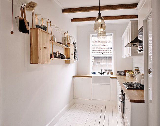 small kitchen / wood + white / painted floorboards / buctcher block bench / hook wall storage // swedish summer home | frag woodall
