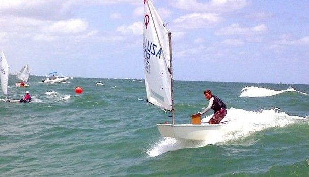 Opti Racing downwind. Sail could be out more, sprit could be looser, and he could be sitting down! lol