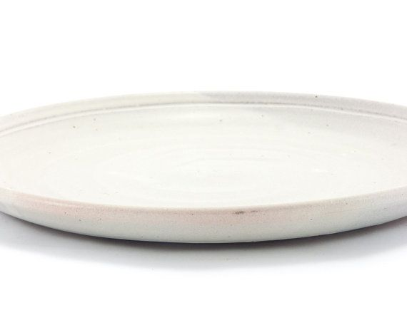 Satin-smooth white linen glaze over red-brown stoneware. Simple classic coup-style dinner plate.