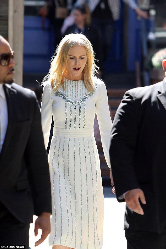 Riding solo: Despite appearing at the Toronto Film Festival two days earlier with beau Keith Urban, Australian actress Nicole Kidman was solo as dazzled crowds on Saturday in Toronto, flaunting a long white dress that hugged her enviable figure