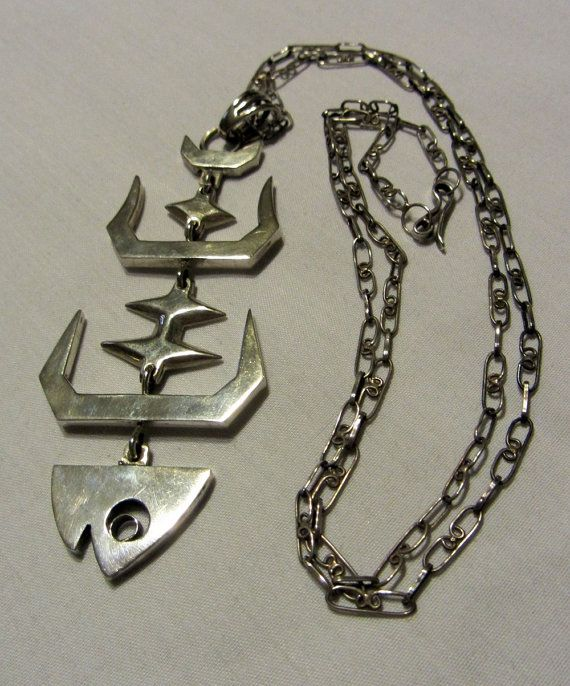 Reserved vintage taxco sterling silver articulated fish for Fish skeleton necklace
